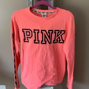 Victoria's Secret sweatshirt.